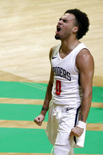 Richmond guard Jacob Gilyard (0) reacts after a three point shot against Toledo during the first half of an NCAA college basketball game in the first round of the NIT, Wednesday, March 17, 2021, in Denton, Texas.(AP Photo/Ron Jenkins)