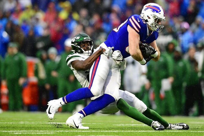 New York Jets' Marcus Maye, left, tackles Buffalo Bills' Tommy Sweeney during the second half of an NFL football game Sunday, Dec. 29, 2019, in Orchard Park, N.Y. (AP Photo/David Dermer)