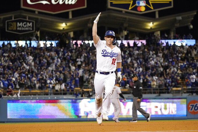 Los Angeles Dodgers' Will Smith runs the bases after he hit a two-run home run during the eighth inning of Game 4 of the baseball team's National League Division Series against the San Francisco Giants, Tuesday, Oct. 12, 2021, in Los Angeles. The Dodgers won 7-2. (AP Photo/Marcio Jose Sanchez)