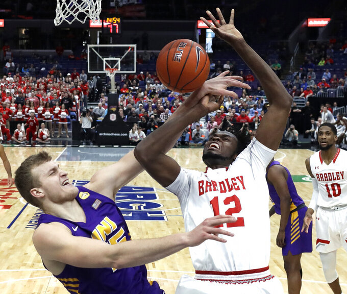 Bradley's Koch Bar, right, is fouled on his way to the basket by Northern Iowa's Justin Dahl during the first half of an NCAA college basketball game in the championship of the Missouri Valley Conference tournament, Sunday, March 10, 2019, in St. Louis. (AP Photo/Jeff Roberson)