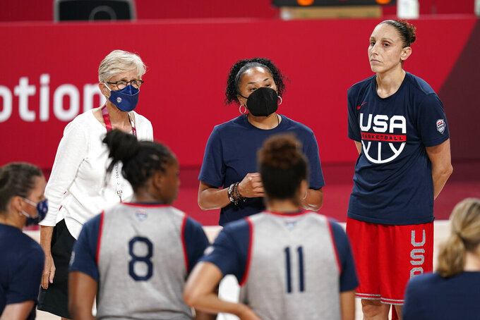 United States head coach Dawn Staley, center, talks to her team during a women's basketball practice at the 2020 Summer Olympics, Saturday, July 24, 2021, in Saitama, Japan. (AP Photo/Charlie Neibergall)