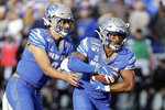Memphis running back Kylan Watkins, right, takes a handoff from quarterback Brady White during the first half of an NCAA college football game against Cincinnati for the American Athletic Conference championship Saturday, Dec. 7, 2019, in Memphis, Tenn. (AP Photo/Mark Humphrey)