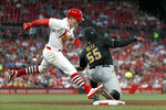 St. Louis Cardinals' Tyler O'Neill, left, is safe at first for a single as Pittsburgh Pirates first baseman Josh Bell (55) handles the throw during the fourth inning of a baseball game Tuesday, July 16, 2019, in St. Louis. (AP Photo/Jeff Roberson)