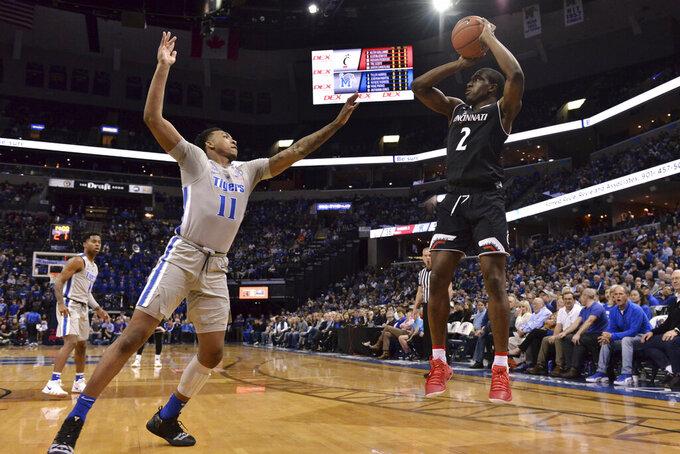 Cincinnati guard Keith Williams (2) shoots against Memphis guard Antwann Jones (11) in the second half of an NCAA college basketball game Thursday, Feb. 7, 2019, in Memphis, Tenn. (AP Photo/Brandon Dill)
