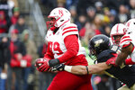 Nebraska defensive lineman Darrion Daniels (79) is tackled by Purdue running back Zander Horvath (40) after an interception during the first half of an NCAA college football game in West Lafayette, Ind., Saturday, Nov. 2, 2019. (AP Photo/Michael Conroy)