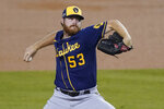 Milwaukee Brewers starting pitcher Brandon Woodruff winds up during the second inning in Game 2 of the team's National League wild-card baseball series against the Los Angeles Dodgers on Thursday, Oct. 1, 2020, in Los Angeles. (AP Photo/Ashley Landis)