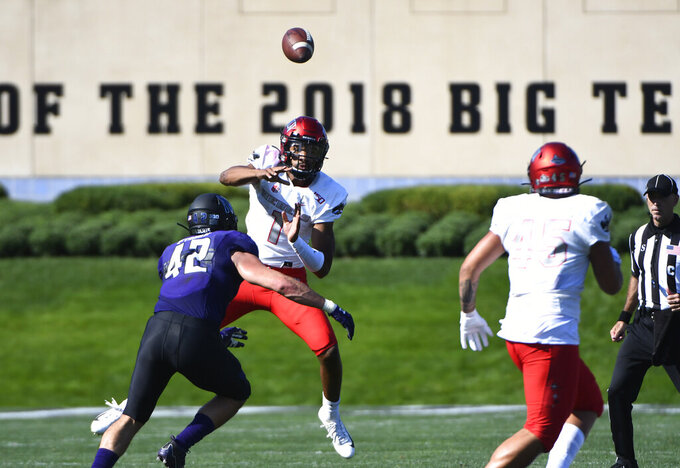 UNLV quarterback Armani Rogers (1) passes against Northwestern during the first half of an NCAA college football game, Saturday, Sept. 14, 2019, in Evanston, Ill. (AP Photo/Matt Marton)