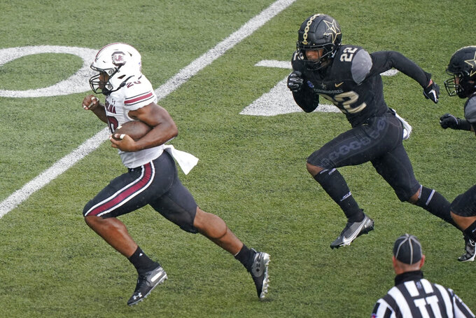 South Carolina running back Kevin Harris (20) leaves Vanderbilt defensive back Chase Lloyd (22) behind as Harris runs 25 yards for a touchdown in the second half of an NCAA college football game Saturday, Oct. 10, 2020, in Nashville, Tenn. (AP Photo/Mark Humphrey)