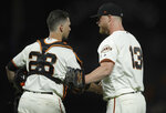 San Francisco Giants pitcher Will Smith, right, celebrates the team's 4-2 win over the San Diego Padres with catcher Buster Posey (28) after a baseball game Wednesday, June 12, 2019, in San Francisco. (AP Photo/Ben Margot)
