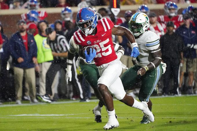 Mississippi running back Henry Parrish Jr. (25) runs past Tulane defenders on his way to a touchdown during the first half of an NCAA college football game, Saturday, Sept. 18, 2021, in Oxford, Miss. (AP Photo/Rogelio V. Solis)