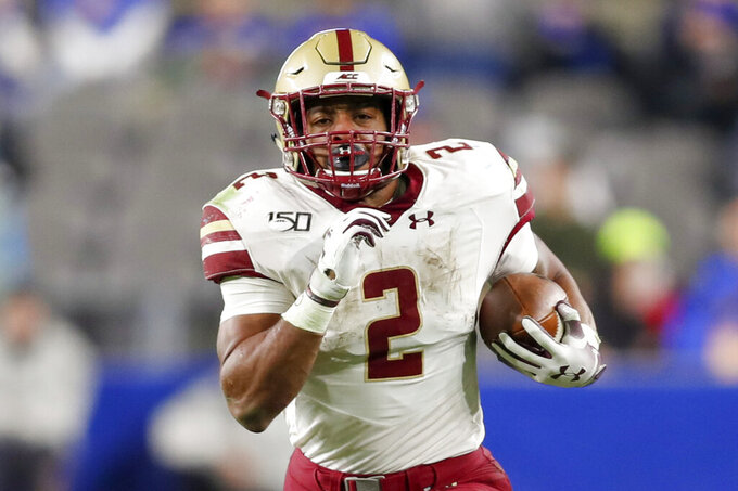 Boston College running back AJ Dillon (2) runs over 50 yards for a touchdown against Pittsburgh during the second half of an NCAA college football game, Saturday, Nov. 30, 2019, in Pittsburgh. (AP Photo/Keith Srakocic)