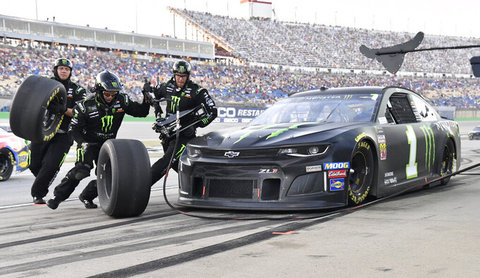 The Latest: Kurt Busch beats little brother to win Kentucky