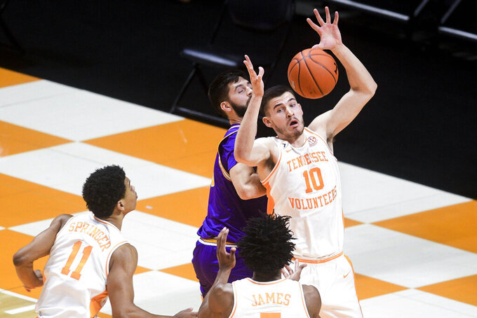 Tennessee's John Fulkerson (10) attempts to rebound during an NCAA college basketball game against Tennessee Tech Friday, Dec. 18, 2020, in Knoxville, Tenn. (Caitie McMekin/Knoxville News Sentinel via AP, Pool)