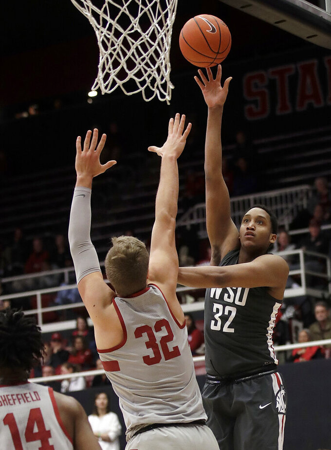 Washington State forward Davante Cooper, right, shoots over Stanford forward Lukas Kisunas during the second half of an NCAA college basketball game in Stanford, Calif., Thursday, Feb. 28, 2019. (AP Photo/Jeff Chiu)