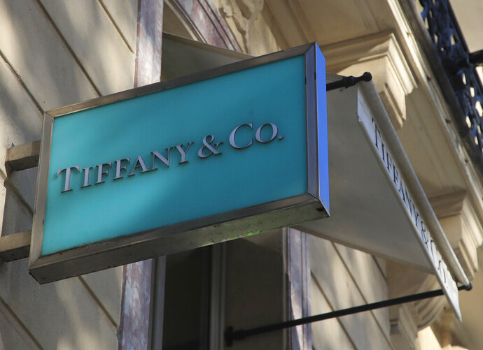 FILE - In this Nov. 25, 2019 file photo, the logo of Tiffany & Co. is pictured on the Champs Elysees avenue in Paris. Luxury conglomerate LVMH Moët Hennessy Louis Vuitton SE has filed a countersuit Monday, Sept. 28, 2020, against Tiffany over their ruined merger deal, noting conditions necessary to close the $14.5 billion acquisition of the jewelry chain have not been met. (AP Photo/Michel Euler, File)