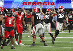 Georgia kicker Jack Podlesny (96) reacts to his game-winning 53-yard field goal with three seconds remaining in the game to beat Cincinnati 24-21 in the NCAA college football Peach Bowl game on Friday, Jan. 1, 2021, in Atlanta.  (Curtis Compton/Atlanta Journal-Constitution via AP)