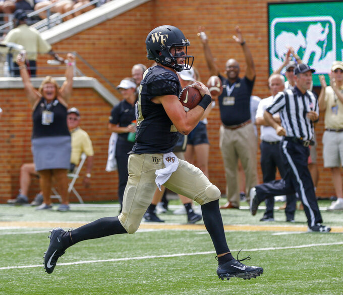 Wake Forest quarterback Sam Hartman rushes for a touchdown against Towson in the first half of an NCAA college football game in Winston-Salem, N.C., Saturday, Sept. 8, 2018. (AP Photo/Nell Redmond)