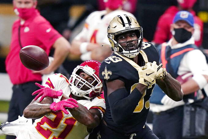 Kansas City Chiefs cornerback Bashaud Breeland (21) breaks up a pass intended for New Orleans Saints wide receiver Juwan Johnson (83) in the second half of an NFL football game in New Orleans, Sunday, Dec. 20, 2020. (AP Photo/Butch Dill)
