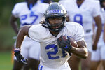 FILE - Duke running back Mataeo Durant carries the ball during an NCAA college football practice in Durham, N.C., in this Thursday, Aug. 5, 2021, file photo. The Blue Devils are coming off a two-win season. (AP Photo/Gerry Broome, File)