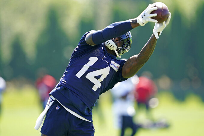 FILE - Seattle Seahawks wide receiver DK Metcalf makes a catch during NFL football training camp, Friday, Aug. 14, 2020, in Renton, Wash. Metcalf didn't disappoint in his rookie season even after sliding in the draft. IT's raised the expectations for what many are expecting to be a breakout season for Seattle's second-year wide receiver. (AP Photo/Ted S. Warren, Pool, FIle)