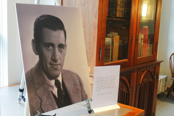 """FILE - In a Tuesday, Jan. 22, 2019 file photo, a previously unseen photo of author J.D. Salinger is displayed at the University of New Hampshire in Durham, N.H. 'The Catcher in the Rye' author is going digital The late J.D. Salinger is giving in to the digital revolution. Longtime Salinger publisher Little, Brown and Company says it's the first time that the entirety of Salinger's published work, including """"The Catcher and the Rye,"""" will be available as e-books. The electronic publication is happening Tuesday, August 13, 2019. (AP Photo/Holly Ramer, File)"""
