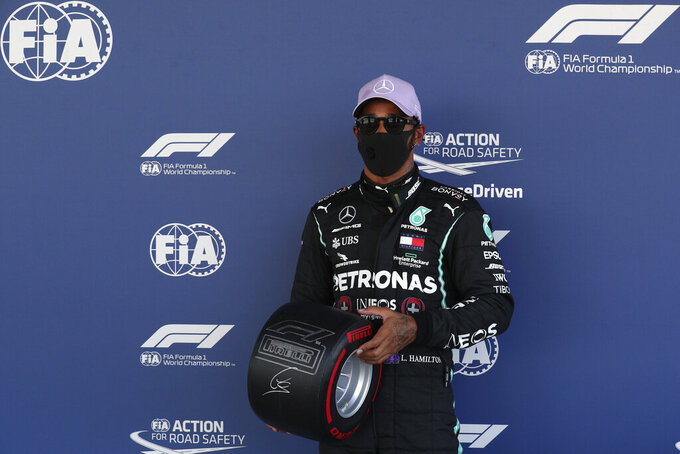 Mercedes driver Lewis Hamilton of Britain poses after the qualifying prior to the Formula One Grand Prix at the Barcelona Catalunya racetrack in Montmelo, Spain, Saturday, Aug. 15, 2020. (Albert Gea, Pool via AP)