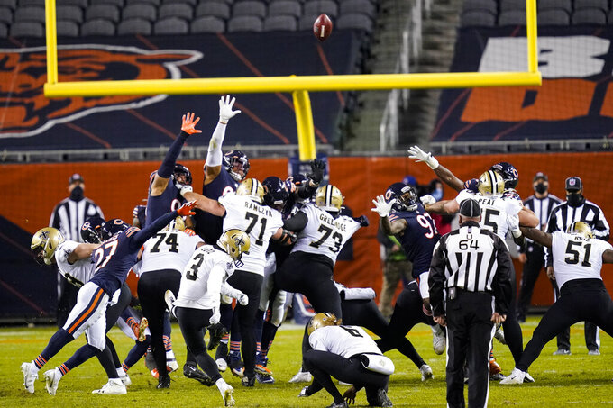 New Orleans Saints kicker Wil Lutz (3) kicks a field during overtime to defeat the Chicago Bears 26-23 in an NFL football game in Chicago, Sunday, Nov. 1, 2020. (AP Photo/Charles Rex Arbogast)