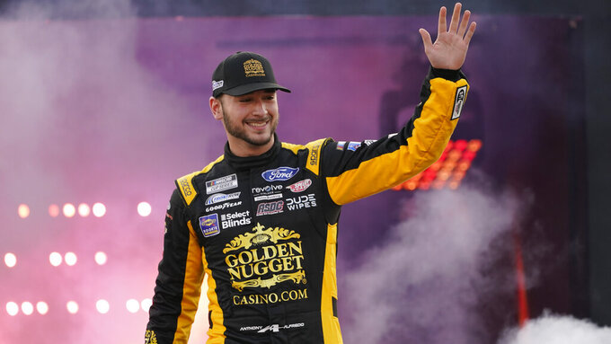 Anthony Alfredo waves to the crowd during driver introductions prior to the start of the NASCAR Cup series auto race in Richmond, Va., Saturday, Sept. 11, 2021. (AP Photo/Steve Helber)