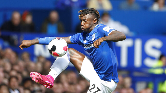 """FILE - In this Sunday, Sept 1, 2019 file photo, Everton's Moise Kean controls the ball during their English Premier League soccer match against Wolverhampton Wanderers at Goodison Park in Liverpool, England. Premier League club Everton says it is """"appalled"""" striker Moise Kean flouted the British coronavirus pandemic lockdown restrictions by partying at home with guests. The Italian filmed himself breaching social distancing regulations and is set to face disciplinary action, it was revealed Sunday, April 26, 2020. (AP Photo/Rui Vieira, file)"""