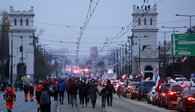 People take part in an annual Independence Day march organized by far-right groups, in Warsaw, Poland, on Wednesday, Nov.11, 2020. The march that marks Poland's sovereignty regained after World War I has often led to clashes with opponents. This year due to coronavirus and social distancing, the march took place in cars and motorbikes. (AP Photo/Czarek Sokolowski)