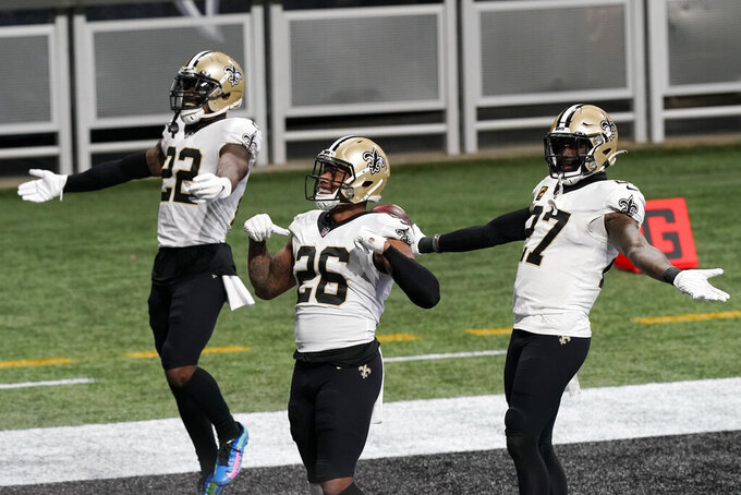 New Orleans Saints players celebrate during the second half of an NFL football game against the Atlanta Falcons, Sunday, Dec. 6, 2020, in Atlanta. (AP Photo/Brynn Anderson)