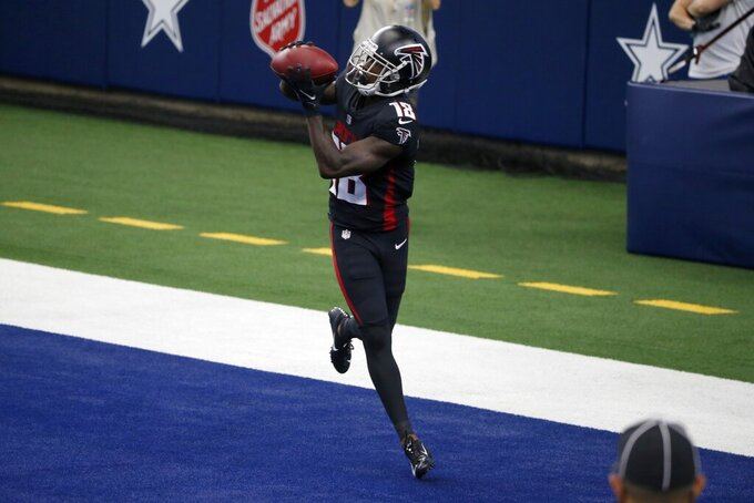 Atlanta Falcons wide receiver Calvin Ridley (18) catches a touchdown pass in the first half of an NFL football game against the Dallas Cowboys in Arlington, Texas, Sunday, Sept. 20, 2020. (AP Photo/Michael Ainsworth)