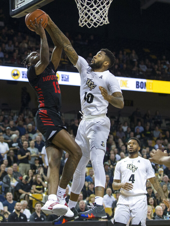 Central Florida's guard Dayon Griffin (10) blocks Houston guard Nate Hinton's (11) shot during the first half of an NCAA college basketball game in Orlando, Fla., Thursday, Feb. 7, 2019. (AP Photo/Willie J. Allen Jr.)