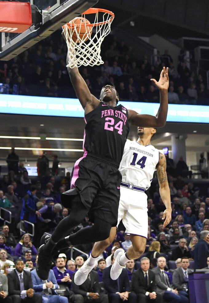 Penn State forward Mike Watkins (24) goes to the basket as Northwestern guard Ryan Taylor (14) defends him during the first half of an NCAA college basketball game Monday, Feb. 4, 2019, in Evanston, Ill. (AP Photo/David Banks)