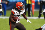 Cleveland Browns running back Kareem Hunt (27) carries the ball against the Tennessee Titans in the first half of an NFL football game Sunday, Dec. 6, 2020, in Nashville, Tenn. (AP Photo/Wade Payne)