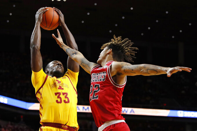 Iowa State forward Solomon Young (33) grabs a rebound over Northern Illinois guard Rod Henry-Hayes during the first half of an NCAA college basketball game, Tuesday, Nov. 12, 2019, in Ames, Iowa. (AP Photo/Charlie Neibergall)