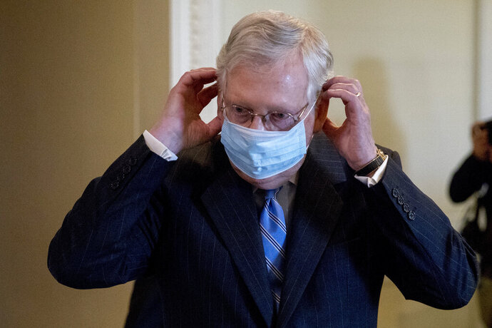 "FILE - In this June 17, 2020, file photo, Senate Majority Leader Mitch McConnell of Ky., leaves a news conference on Capitol Hill in Washington. For more than three years, President Donald Trump instilled such fear in the Republican Party's leaders that most kept criticism of his turbulent leadership or inconsistent politics to themselves. That's beginning to change. While Trump avoids wearing a mask in public, McConnell said facial coverings are ""really important"" until a vaccine is found.  (AP Photo/Andrew Harnik, File)"