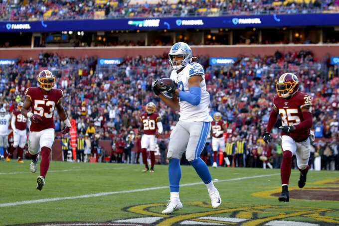 Detroit Lions tight end Logan Thomas, center, scores a touchdown on a pass from quarterback Jeff Driskel, not visible, as Washington Redskins inside linebacker Jon Bostic (53)and free safety Montae Nicholson (35) try to defend during the second half of an NFL football game, Sunday, Nov. 24, 2019, in Landover, Md. (AP Photo/Alex Brandon)
