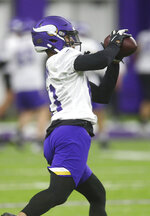 Minnesota Vikings NFL football rookie wide receiver Olabisi Johnson pulls in a pass during workouts Wednesday, May 22, 2019, in Eagan, Minn.  (AP Photo/Jim Mone)