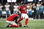 Atlanta Falcons kicker Younghoe Koo (7) works against the Jacksonville Jaguars during the first half of an NFL football game, Sunday, Dec. 22, 2019, in Atlanta. (AP Photo/Danny Karnik)