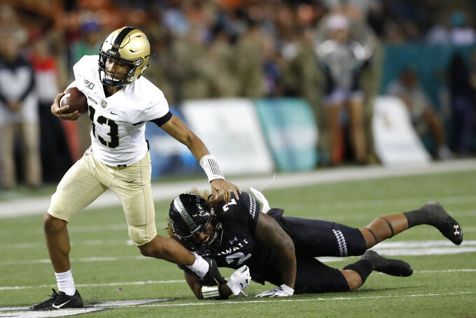 Hawaii linebacker Jeremiah Pritchard (2) tackles Army quarterback Christian Anderson (13) during the second half of an NCAA college football game Saturday, Nov. 30, 2019 in Honolulu. (AP Photo/Marco Garcia)