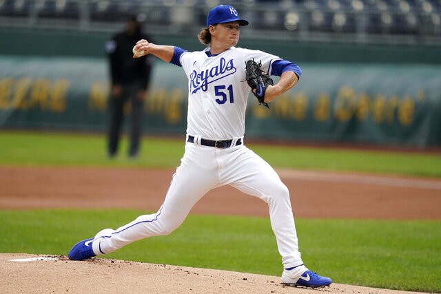 Kansas City Royals starting pitcher Brady Singer delivers to a Detroit Tigers batter during the first inning of a baseball game at Kauffman Stadium in Kansas City, Mo., Sunday, Sept. 27, 2020. (AP Photo/Orlin Wagner)