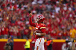 Kansas City Chiefs quarterback Patrick Mahomes celebrates as time expires in an NFL football game against the Cleveland Browns Sunday, Sept. 12, 2021, in Kansas City, Mo. (AP Photo/Charlie Riedel)