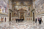 US Vice President Mike Pence, second from left, and part of his delegation are given a private tour of the Vatican after his private audience with Pope Francis, at the Vatican, Friday, Jan. 24, 2020. The pontiff and the vice president had a private hour-long conservation.  (Alessandro Di Meo/Pool Photo via AP)