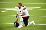Chicago Bears quarterback Nick Foles (9) kneels on the field in the closing minutes of a loss to the Los Angeles Rams in an NFL football game Monday, Oct. 26, 2020, in Inglewood, Calif. (AP Photo/Kelvin Kuo)