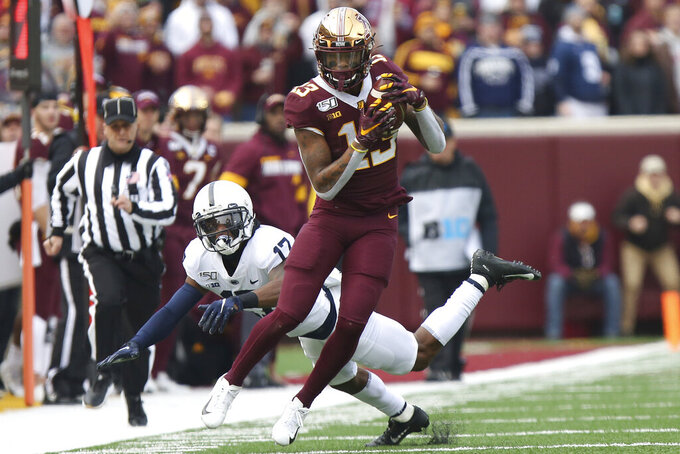 Minnesota wide receiver Rashod Bateman (13) holds onto the ball against Penn State safety Garrett Taylor (17) during an NCAA college football game, Saturday, Nov. 9, 2019, in Minneapolis. (AP Photo/Stacy Bengs)