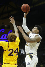 California forward Andre Kelly, right, shoots over Arizona State forward Jalen Graham (24) during the first half of an NCAA college basketball game in Berkeley, Calif., Sunday, Feb. 16, 2020. (AP Photo/Jeff Chiu)