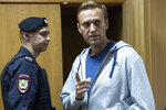 FILE - In this Monday, Aug. 27, 2018 file photo, Russian opposition leader Alexei Navalny gestures while speaking in a court room in Moscow, Russia. Police are raiding homes and offices of supporters of Russian opposition leader Alexei Navalny in 43 Russian cities, his close allies said Thursday Sept. 12, 2019. (AP Photo/Pavel Golovkin, File)