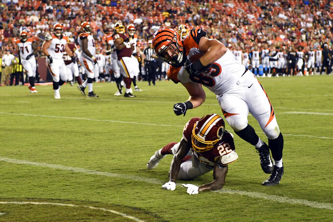 Cincinnati Bengals tight end Drew Sample (89) runs over Washington Redskins defensive back Deshazor Everett (22) for a touchdown during the second quarter of an NFL preseason football game in Landover, Md., Thursday, Aug. 15, 2019. (AP Photo/Susan Walsh)