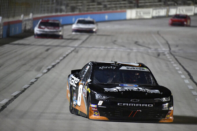 Jeb Burton heads into Turn 1 during NASCAR Xfinity auto race at Texas Motor Speedway in Fort Worth, Texas, Saturday, Nov. 2, 2019. (AP Photo/Larry Papke)